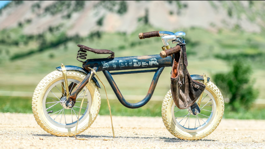 Her last build was a custom Strider bike for the Flying Piston Benefit. It is now at Mecum Auctions.